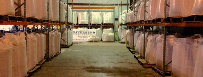 New Riverbend Sign Next to Bags of Malt