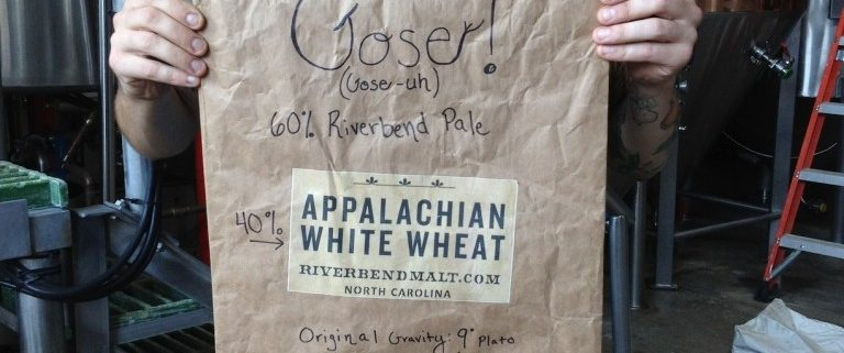 Todd Gose Holding an Appalchian White Wheat Malt Bag